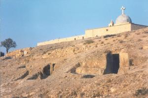 Mar Sarkis and the neighboring monastic caves. Photographed by the author in 1996.