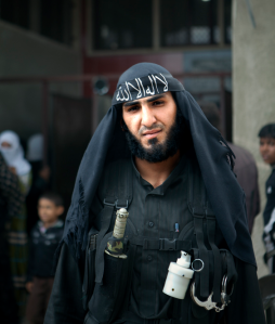 A widely circulated image of an Al-Nusra fighter in Northern Syria. A highly sophisticated chemical riot control grenade can be seen, indicating outside state-sponsorship. This image and others, was the focus of a number of Syria weapons watch websites speculating whether or not the rebels had chemical weapons capabilities.